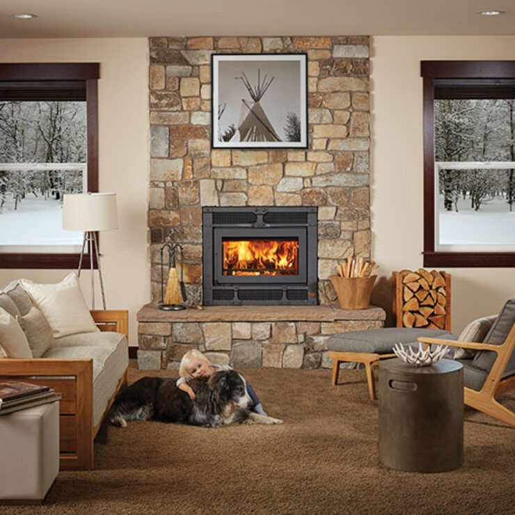 The 42 Apex™ is designed to deliver high-performance, clean-burning heat while showcasing a spectacular view of the fire. Express your personal style with one of the three available faces, like the Custom Shop hand-crafted Timberline™ to the right. This cozy great room also showcases the Custom Shop Hand-Hewn Timber Mantel & Legs, and the In-Wall Control Center with GreenStart ® Igniter.