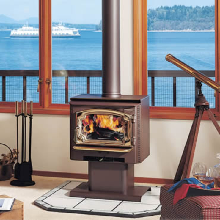 """The Answer NexGen-Fyre™ is a beautiful small stove built with heavy-duty, high quality construction. This stove uses a five-sided convection chamber to distribute heat evenly throughout your home. Cool room air is naturally drawn around the hot firebox, heated, and returned back into room without using a convection fan. The Answer's™ 1.5 cubic foot firebox is large enough to hold an 18"""" log, offering longer burn times with less reloading. Alcove and Mobile Home approved."""