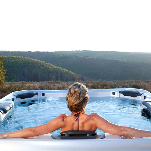 Woman in Bullfrog Spas Outdoor