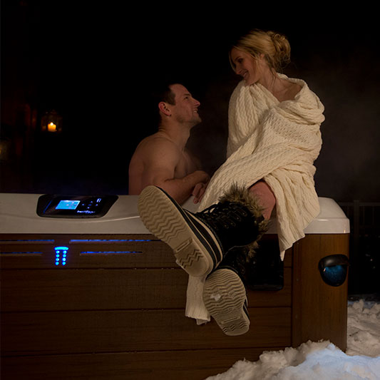Couple in Bullfrog Spas Outdoor
