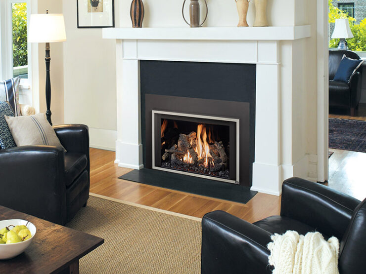 """The 616 is an excellent heater and beautiful focal point for larger homes and grand spaces up to 2,000 square feet. This insert features our biggest fireview, with 616 square inches of ceramic glass that extends down to the hearth. This creates a """"clean face"""" look with minimal metal facing and a larger fireview than other inserts its size. This model has a gorgeous flame appearance and features the Ember-Fyre™ II burner with Ember-Glo™ ember bed lighting."""