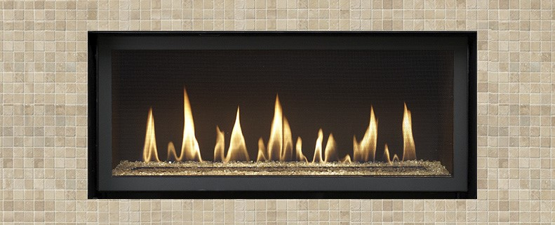 """The 3615 is the smallest model in our HO (High Output) Linear lineup. This fireplace is perfect for intimate spaces like bedrooms and cozy dens. The 3615 features 33,000 BTUs and has a heating capacity of up to 1,700 square feet. This """"clean face"""" fireplace has very little metal surrounding the glass and offers you the choice of minimal trims, along with beautiful Fyre-Art™ options."""